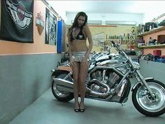 Lovely babe Denisa masturbating pink pussy on bike