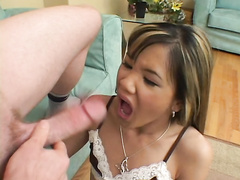 Petite Asian hottie Kitty takes monster cock deep