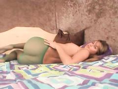 Horny babe makes holes in pantyhose to masturbate