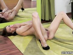 Horny brunette babe masturbates in front of mirror