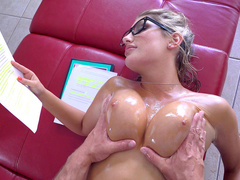 Nerdy student August Ames lets friend oil up and rub her juicy tits
