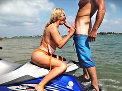 Nikki Benz with sunglasses sits on jet ski and gives XXX blowjob outdoors
