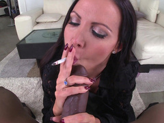 XXX pornstar Nikki Benz smokes cigarette and big black penis on camera