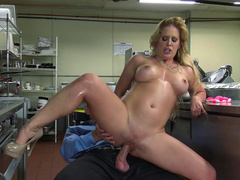 Horny cougar Cherie DeVille jumps on waiter's cock in middle of kitchen