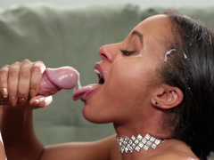 Anya Ivy jerks off Johnny Sins's cock till he cums on her face and in her mouth