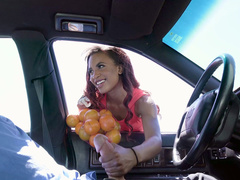 Ebony Demi Sutra is sucking the hard white cock in the car