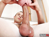 Kinky dude Peter in nylons fucks his cock with toy